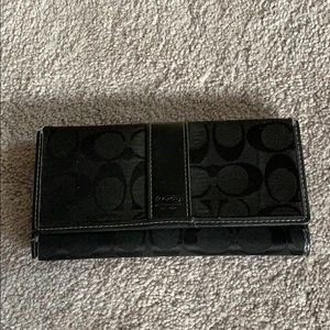 Trifold coach wallet with pockets